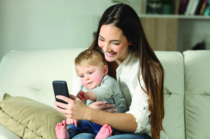 child and mom using telemedicine