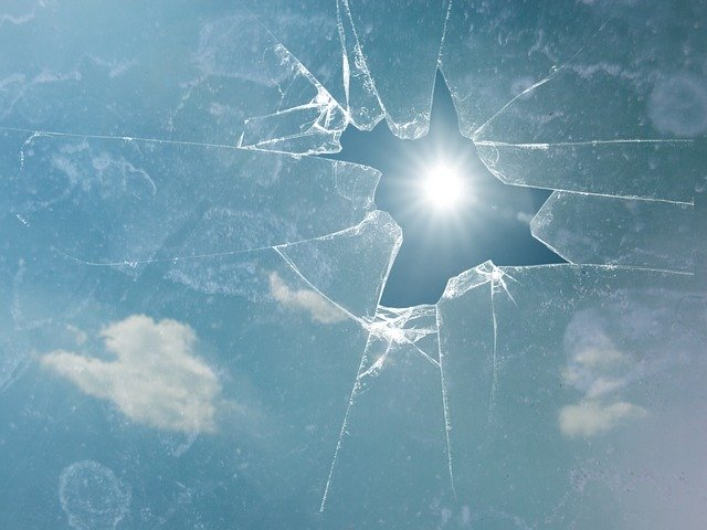 Broken window with sun shining